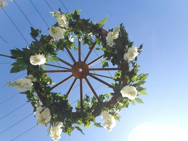 Hanging floral wagon wheel by My Dandy Day.