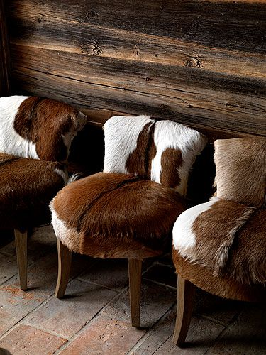 Rustic drama: Occasional chairs with hide upholstery.