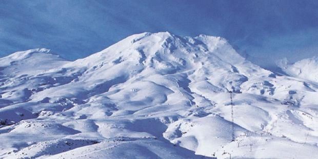 New Zealand's largest ski area - Mt Ruapehu. Go Turoa! The Happy Hobbit Love Shack is in Ohakune, on the Turoa side. Wish we spent more time there...