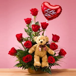 This small red cupid that carries the legendary legend of those three words that a lover would like to utter apart from a dozen red roses arranged in a pyramidal fashioon and greens.. http://www.pickupflowers.com/send-love-and-romance-flowers-to-usa