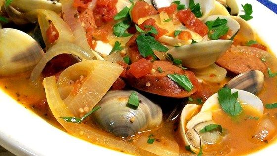 Being of Portuguese descent and raised in Rhode Island along the Eastern seaboard, this recipe is a wonderful combination of my two heritages. If desired serve with a small cup of melted butter for dipping clams and don't forget a fresh loaf of warm, crusty bread!
