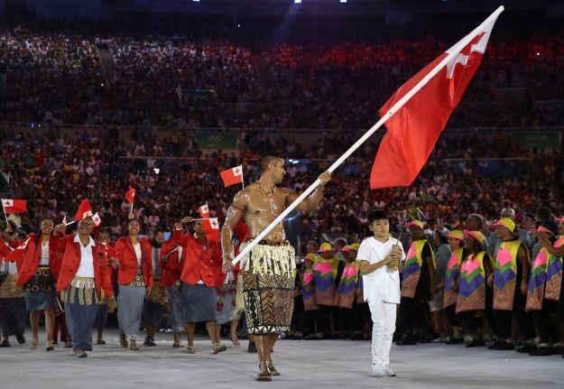 This is taekwondo player Pita Taufatofua, leading Tonga's team of seven athletes. | Tonga's Oiled Up Flag Bearer Was The Highlight Of The…
