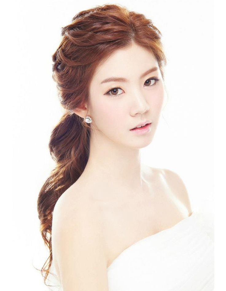 Coiffure de mariée Queue-de-cheval ondulée - Les plus jolies coiffures de mariée…