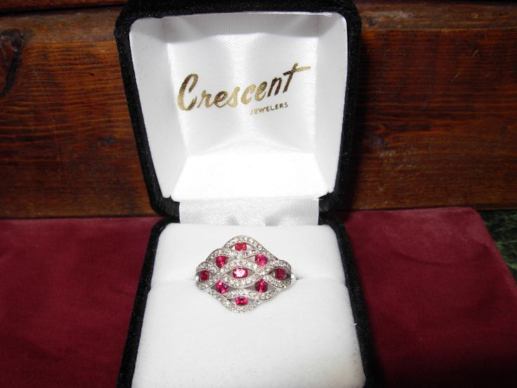 Ruby ring with diamond twist design featuring miligrain beading along twist