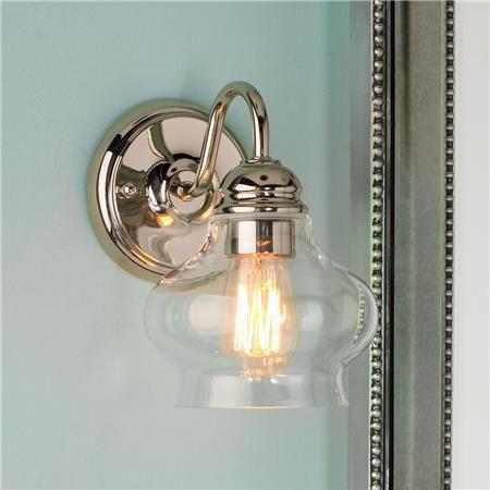 I love this light...it's a little traditional, a little contemporary. In polished nickel or bronze.