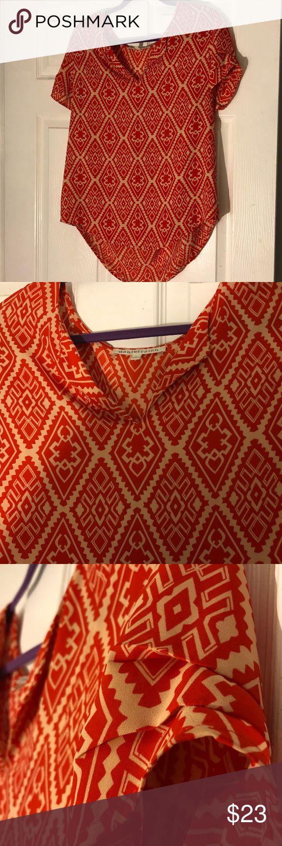 Daniel Rainn blouse. Daniel Rainn short sleeve Aztec blouse. Size M. Red has somewhat of an orange hue. Daniel Rainn Tops Blouses