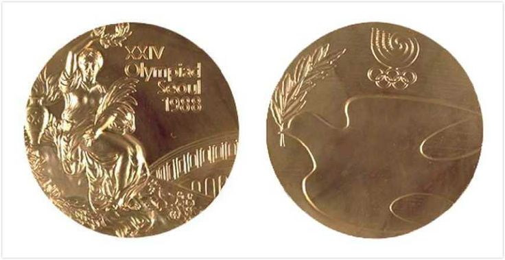 Seoul, South Korea 1988 Summer Olympics Medals.  Modernist again, with a dove carrying a laurel sprig and the Seoul Olympic logo – an ancient Korean Taegeuk symbol, like that on the national flag.