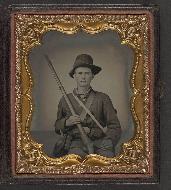 [Unidentified young soldier in Union uniform and Hardee hat sitting with musket, cartridge box, and cap box] (LOC) by The Library of Congress, via Flickr