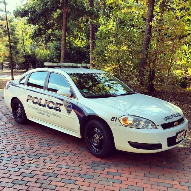 """UNC Chapel Hill police car, University of North Carolina at Chapel Hill, Chapel Hill, NC  """"Though it be given him to be in safety, whereon he resteth; yet his eyes are upon their ways"""" (Job 24:23)"""