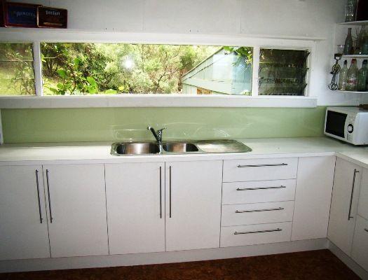love the long window and green splash back