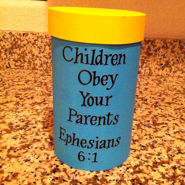 Consequence Jar full of wooden craft sticks with consequences for poor behavior written on them.
