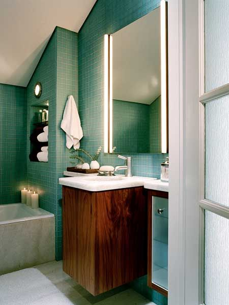 This small San Francisco bathroom had no direct access to natural light -- and since it's on the top floor of a pitched-roof house, one side of the room has a low, slanted ceiling. Getting natural light into the room required going up through the attic to create a skylight.
