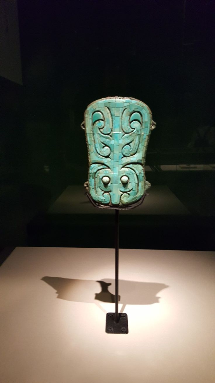 """Bronze plaque inlaid with turquoise, Xia/early Shang Dynasty period, exhibited in the """"Galaxy of Jade at Jinsha - Exhibition of Jade Culture During Xia-Shang Periods"""" at Jinsha Museum in Sichuan Province, China"""
