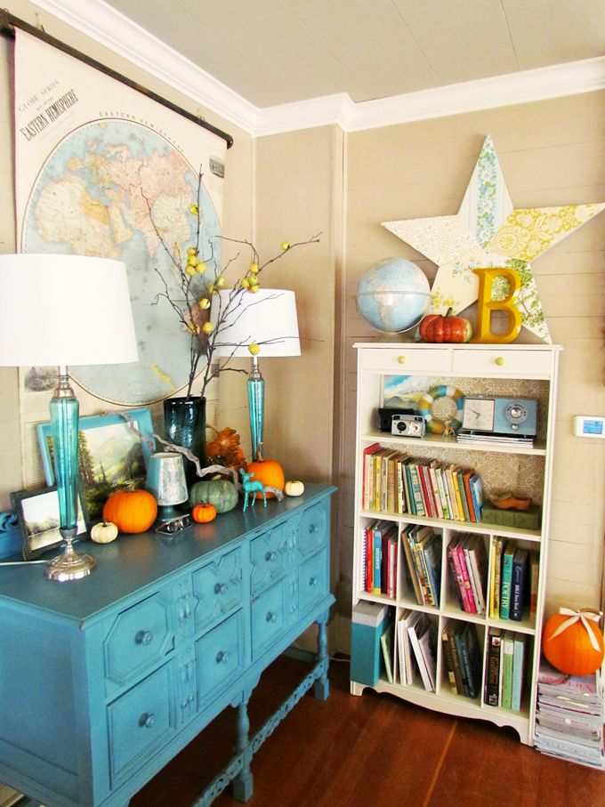 Blue White And Pops Of Orange Make For A Cozy Corner With