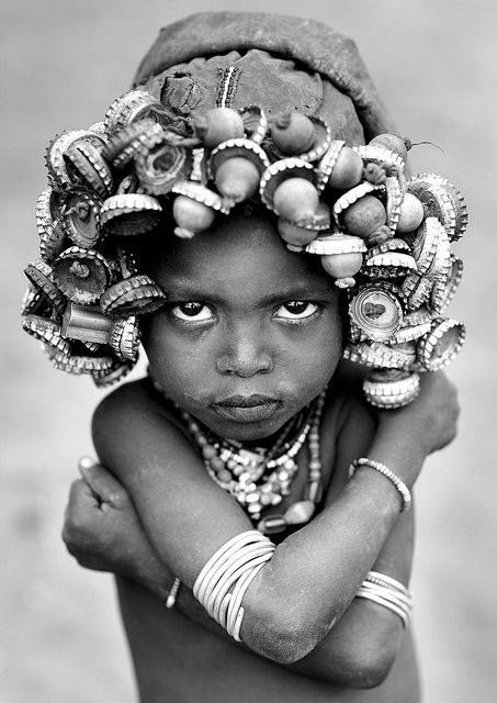 ethiopian boy with head piece made of bottle caps.