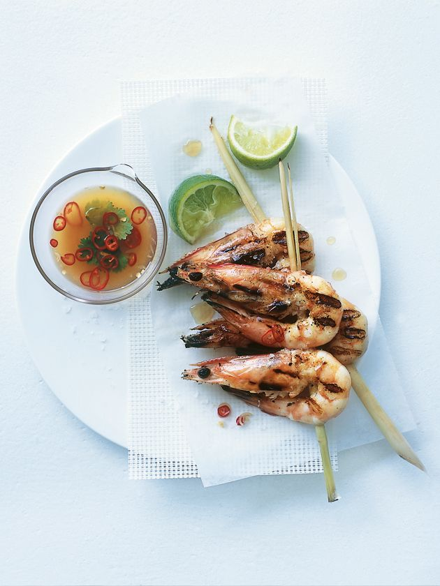 Thread prawns onto lemongrass stalks (cut on angle to make a point to stab the prawn with), brush w oil and BBQ 3 mins each side then serve w dip made from fish sauce, lime juice, chopped lemongrass, fresh coriander (cilantro) and chile plus lime wedges to serve...exact recipe on Donna Hay website!