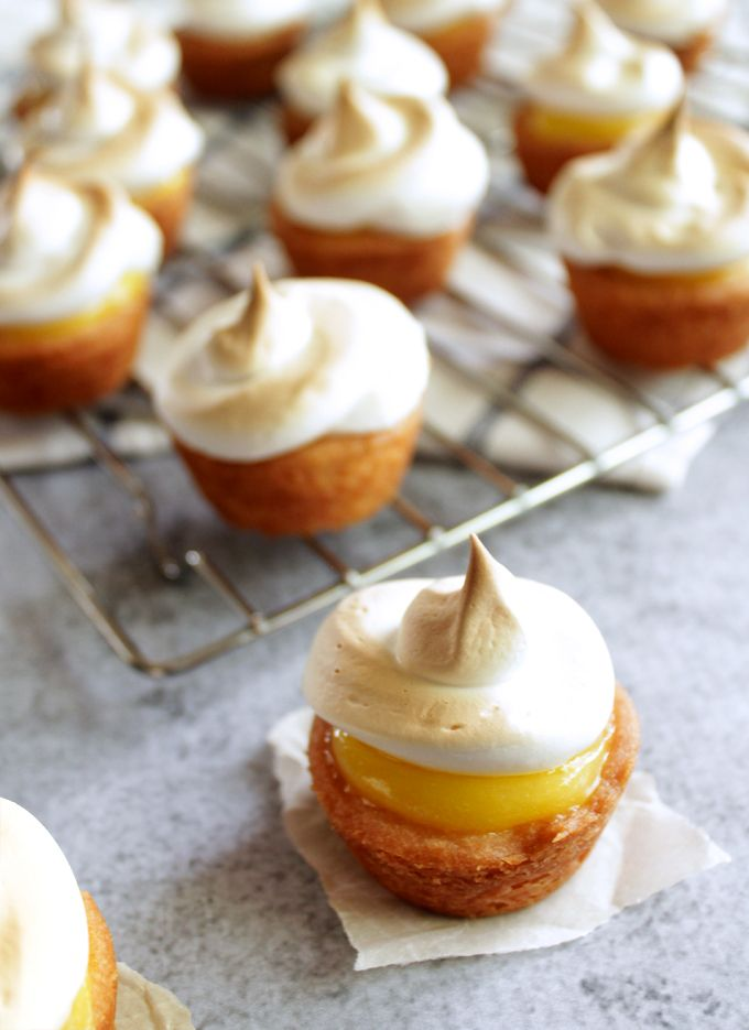 two-bite lemon meringue pies are a great idea for a spring cocktail party to end with something sweet and tangy. #letmeentertainyou PS they are cute, also...