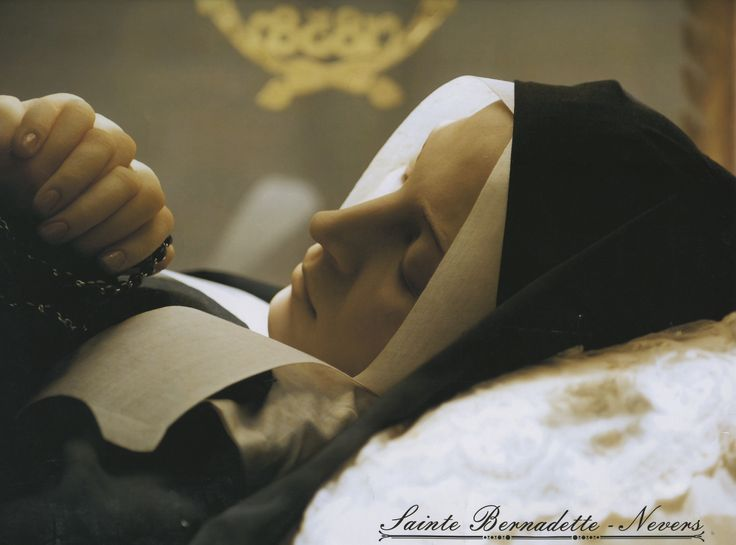 The incorrupt body of St. Bernadette Soubirous at Nevers, France... She looks like she is just sleeping.