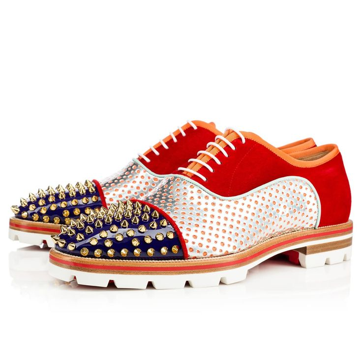 """""""Hubertus Orlato Spikes"""" brings new energy to the classic oxford silhouette. Cloaked in a dynamic blend of materials with a gold spiked toe box and Loubi red lined sole, this vivid lace-up is a fiesta for the feet."""