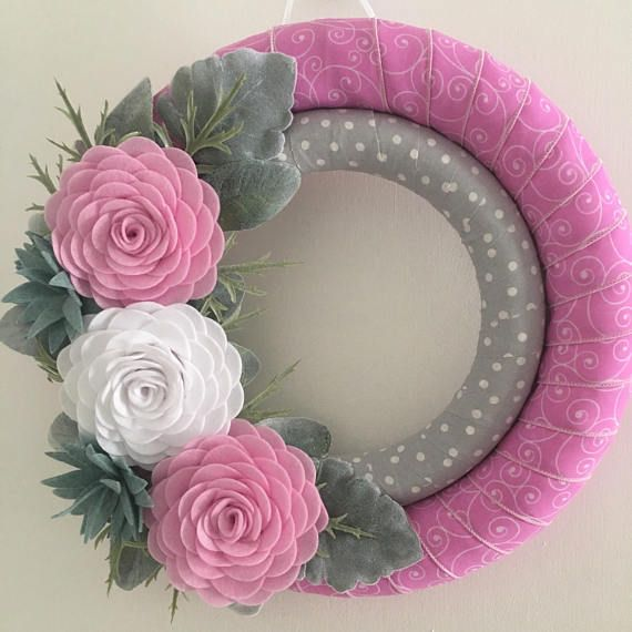 "Handmade pink felt flower ribbon wrapped wreath. Wreath form measures 14""."