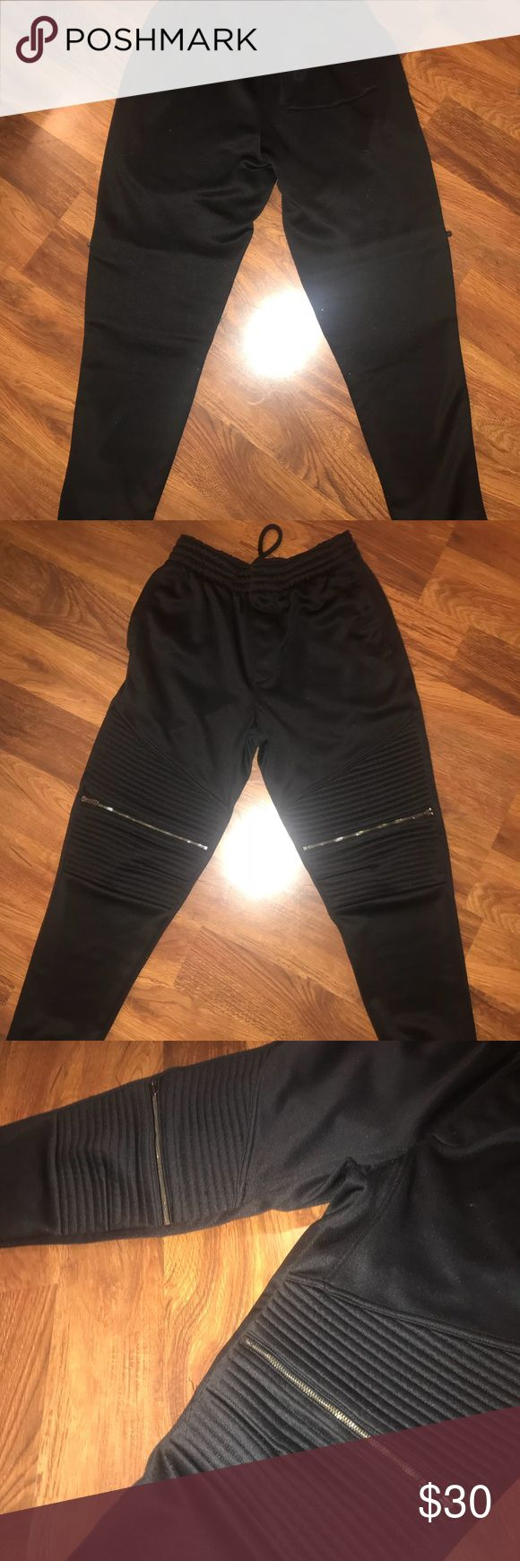 Champs men's black joggers with zippers size small Black, gently used men's joggers. Size small. Really comfy! No tears or stains. From Champs. Pants Sweatpants & Joggers