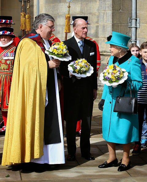 Queen Elizabeth II and Prince Philip, Duke of Edinburgh chat with the Dean of Sheffield Peter Bradley as she leaves Sheffield Cathedral for the traditional Royal Maundy Service at Sheffield Cathedral on 02.04.2015 in Sheffield, England.