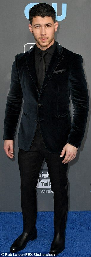 No time to change: When they were seen at dinner, they were wearing their outfits from the awards show; Nick is pictured at the Critics' Choice blue carpet