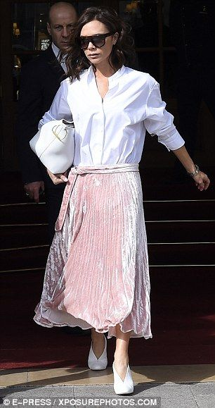 Think pink!The mother-of-four looked stunning in the pale pink number, which fell into stunning soft pleats that billowed as she walked