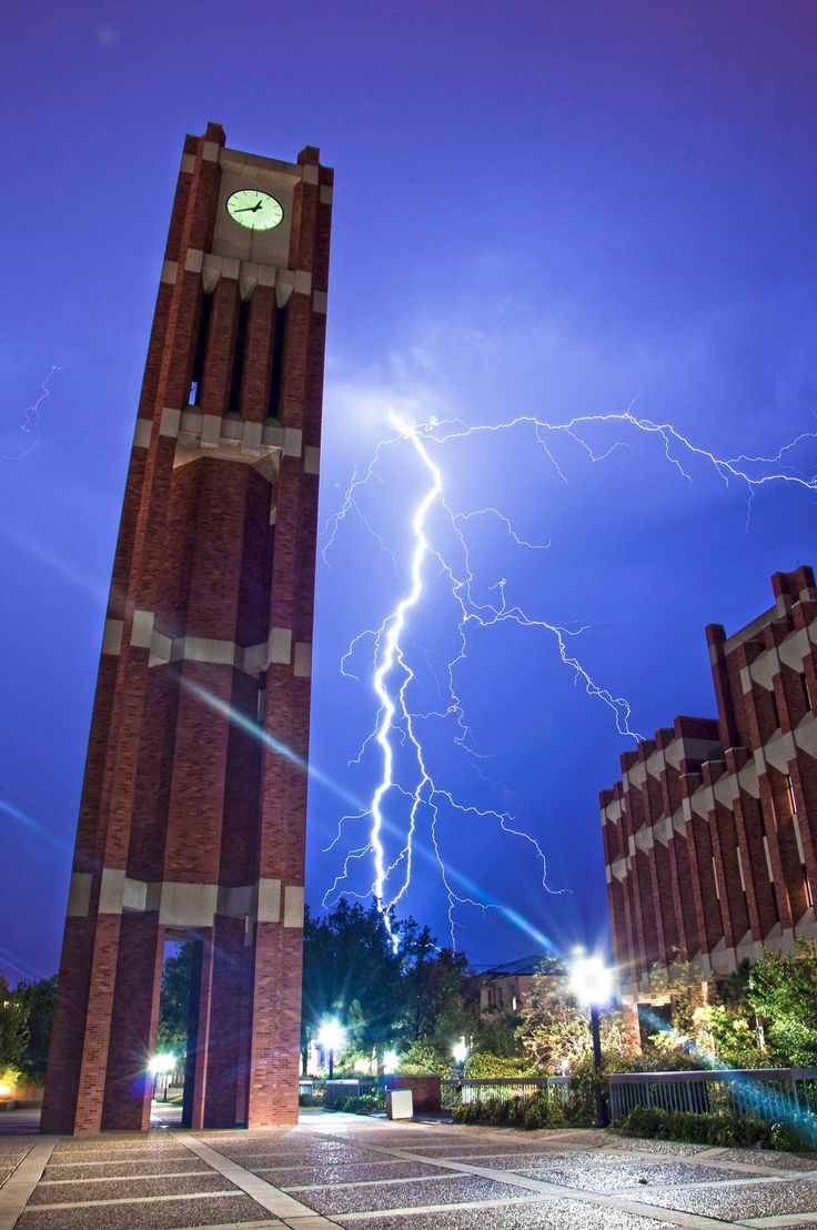 A vivid display of lightning strikes behind the University of Oklahoma clock tower.