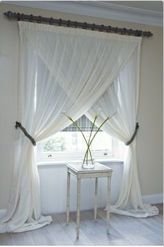 What an interesting twist on hanging curtains in your home. #curtains #drapes