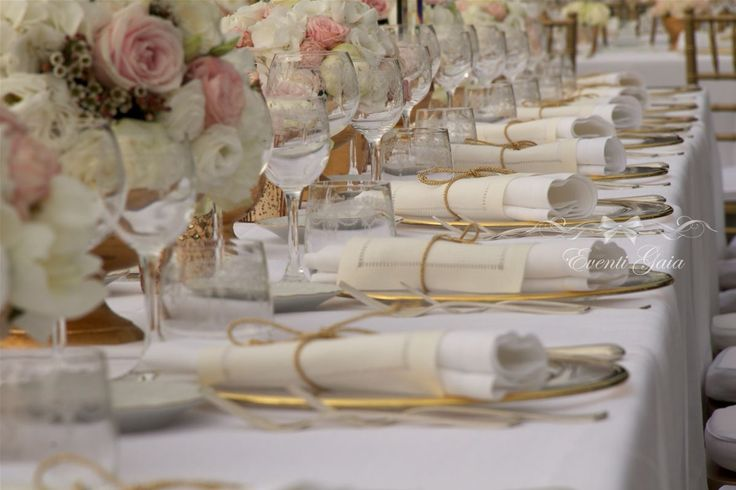 Versailles themed wedding. Gold & Champagne, napkins with gold ribbon, ivory & blush pink flowers ceneterpiece