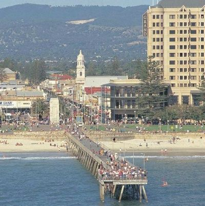 Stunning aerial view of Glenelg Jetty, set against the backdrop of the Adelaide Hills, Adelaide, South Australia.