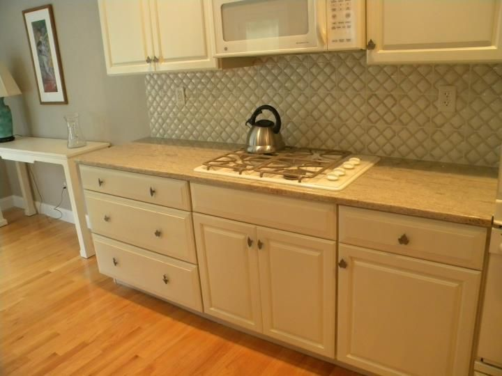 Cream kitchen cabinets are a perfect match with ivory for Perfect kitchen cabinets