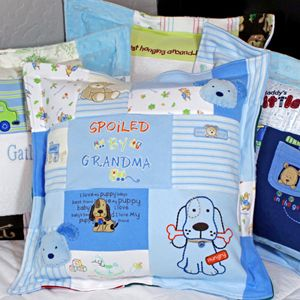 """A cute pillow made out of baby clothes! One for grandma with the """"grandma"""" onesies, one for grandpa, one for dad, etc as gifts! http://www.jellybeanquilts.com"""
