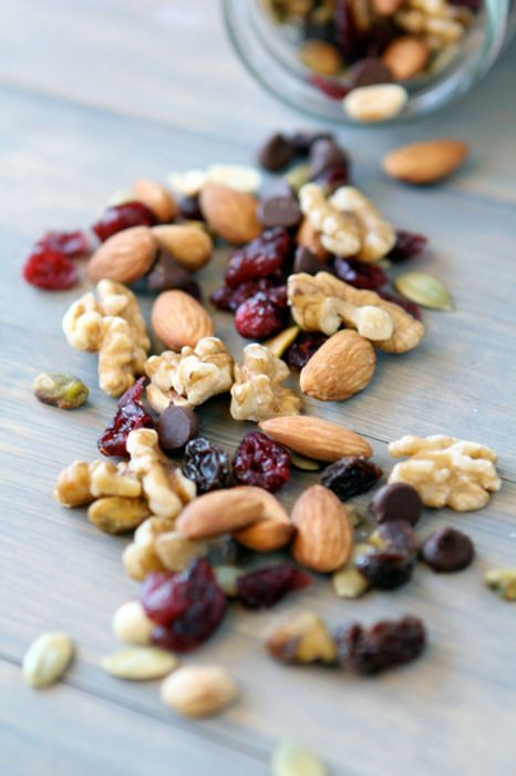 Mix up your own trail mix with nuts, cherries, pumpkin seeds, and a handful of chocolate chips. Stash single portions in your purse, car, or gym bag to have on hand for a quick, energizing snack.