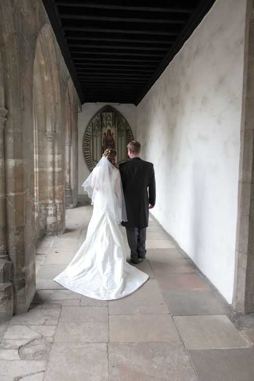 Bride and groom walking down the ancient walkways at The Friars