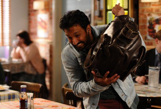 AJ hides from Zainab as she enters the cafe -Eastenders -Grafea Rucksack