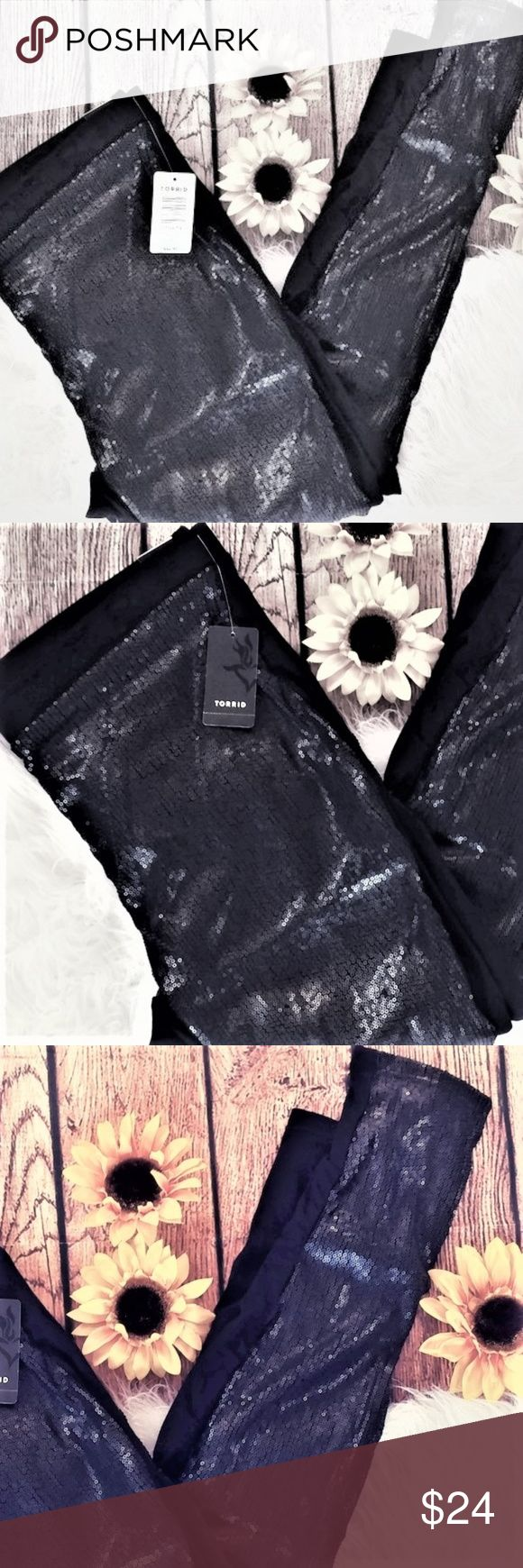 NWT Torrid ON TREND black sequin leggings PLUS 2X NWT Torrid black sequin leggings PLUS SIZE 2X Brand new, never worn. There are two sizes available so please check measurements below. Sequins are only on the front. Gorgeous leggings. Brand new, never worn. 95% cotton, 5% spandex So on Trend for SPRING 2018, Pair with Sequin Tank and Sandals!! Size: 2:  Waist: 17 inches Length: 38 inches Inseam: 28.5 inches  Rise: 10 inches torrid Pants Leggings