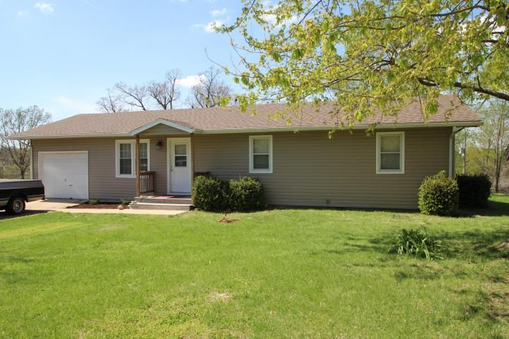 SUPER CUTE HOME ON CORNER LOT! New vinyl siding with some new windows, new interior paint. Great starter home in great location! Large deck on the back with great view. This home qualifies for USDA's 100% financing in Marshfield MO