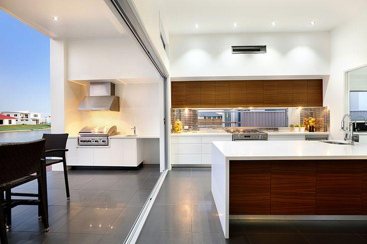 Kitchen design. Sliding doors. BBQ area. Lighting. White. Wood finish. Tiles. Customisation. Modern. Stylish. G.J. Gardner Homes. Australia