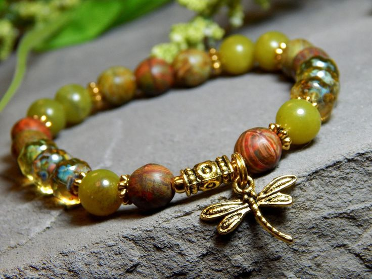 The colors of nature paired with a pretty dragonfly charm. Perfect for the nature lovers. Gemstone bracelet made with 8mm Peridot Jasper, Earthy color high quality czech beads, Yellow crystal rondelle