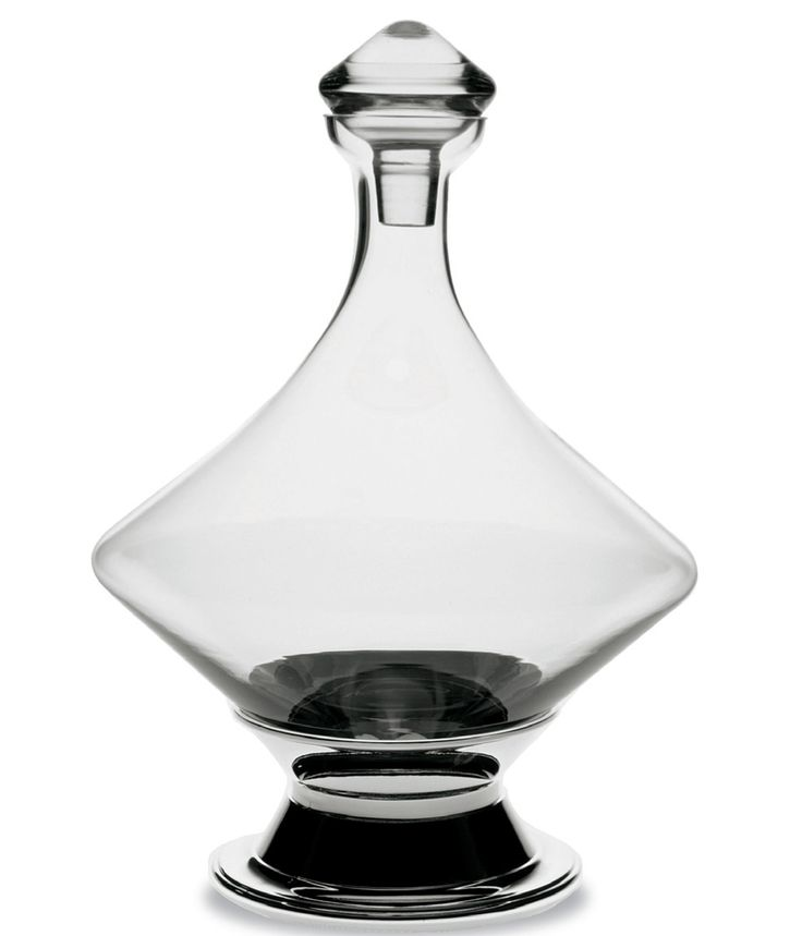 "Zerrutti Turn Decanter. A very effective design to breathe wine quickly, based on an ancient shape. This crystalline decanter is able to ""roll"" around the table gently swirling the wine, which allows the entire contents to come in contact with air. Stored on a silver nickel plated brass base when not in use."