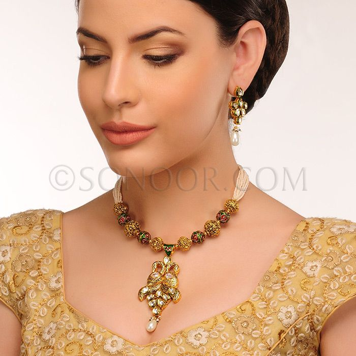 PEN/1/3435	 Seri Pendant Set with Earrings in dull gold finish studded with kundan and meena kari 	$178	£105