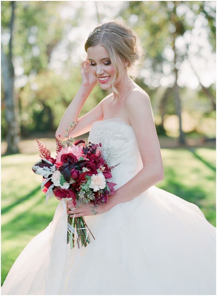 Let down a wavy strand for a romantic addition to your Wedding Updos - Photographer: Carmen Santorelli