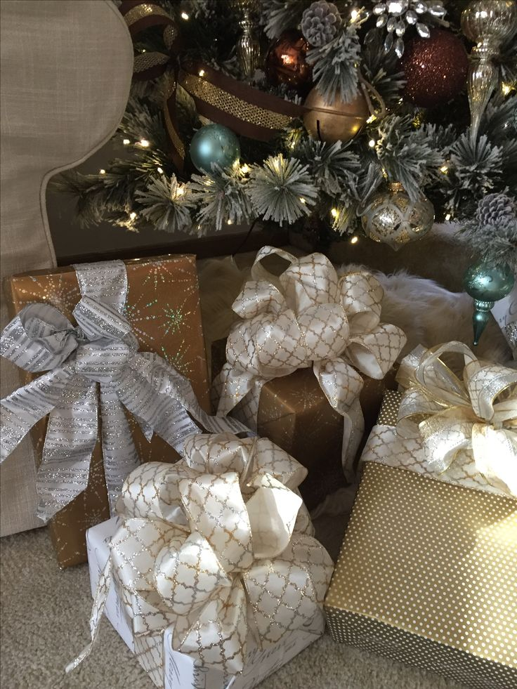 Some of my presents are already wrapped. Beautiful paper and ribbons from PaperMart.com