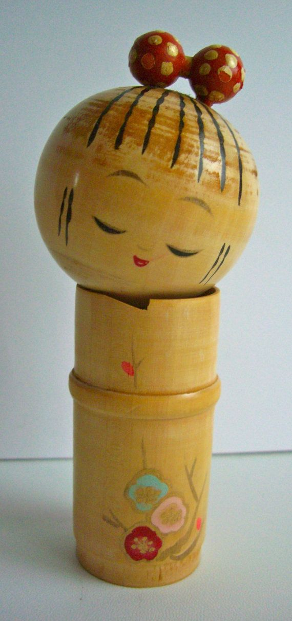 Japanese kokeshi doll in very good condition. DIMENSIONS  height 14.5 cm  weight 120 grams    What are kokeshi dolls? Kokeshi are handmade and hand painted wooden dolls from Japan. They are very simple in design, being made from two pieces of wood- one for a large round head, and the other for a cylindrical truck. They are painted with delicate lines to define the facial features, and with colourful designs for the kimono or other clothing. To take care of your kokeshi it is best to keep…