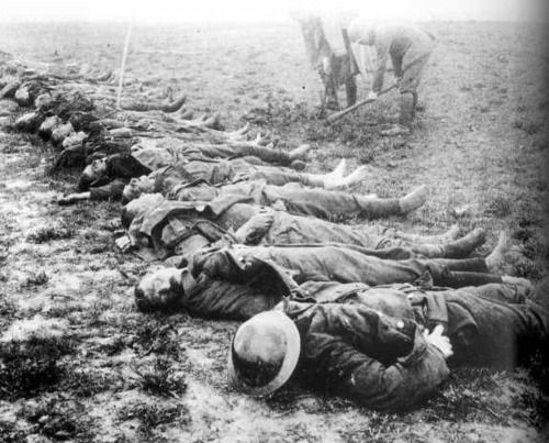 British soldiers awaiting their burial by German soldiers, They all had their shoes removed. WWI