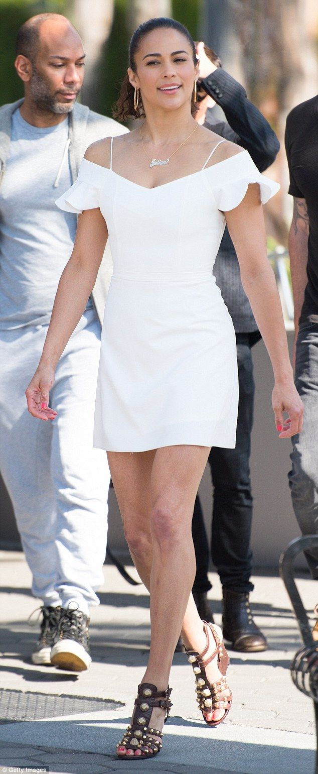 Spring style: Paula Patton was cool in a white off-the-shoulder minidress as she stepped o...