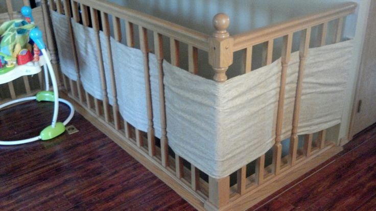 Baby safety for stair railings. Fabric weaved through spindles.