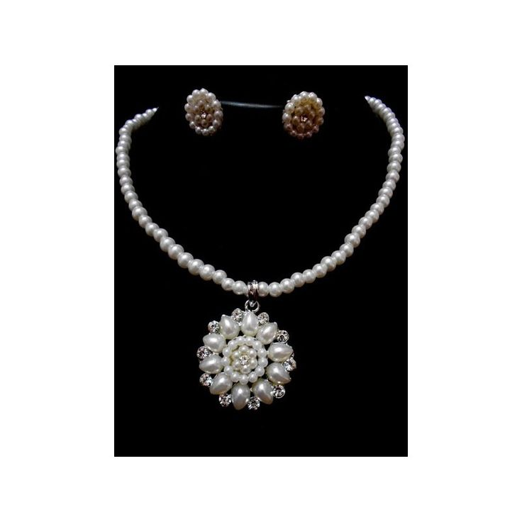 A beautifully designed Pearl CZ Necklace with a pair of Earrings #fashionnecklace #PearlNecklace #PearlJewelry #FashionJewelry #IndianJewelry Available at http://skyfashionshop.com/indian-fashion-necklaces/47-pearl-necklace.html